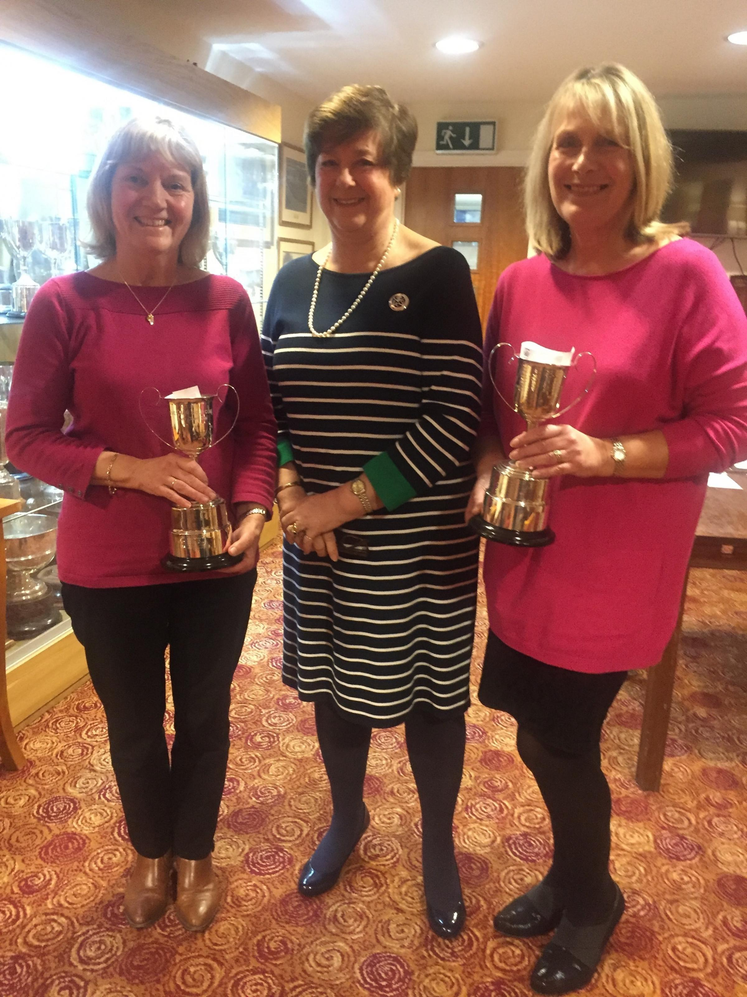 Sally Rogers and Lesley Curnock receive the Nora Olsen Cups from Angela Budden
