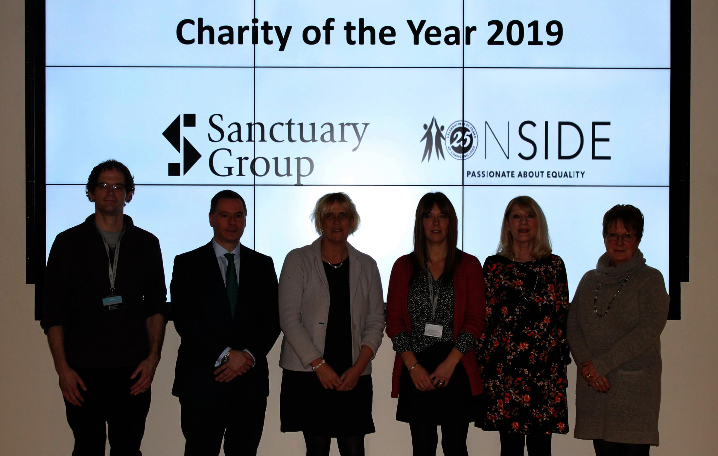 CHARITY: Sanctuary's Group Chief Executive Craig Moule (second from left) with Onside's Chief Executive Kate Harvey (third from left) and staff and service users from Onside.