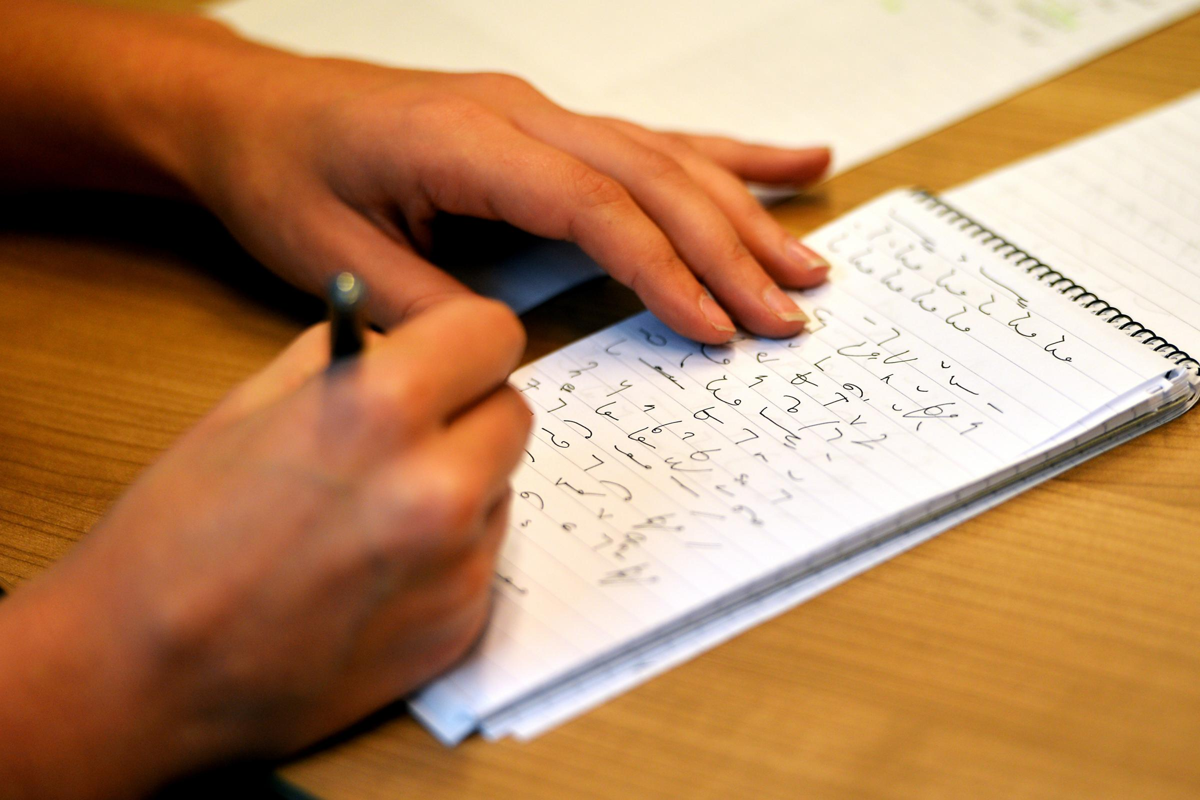 A journalist using shorthand