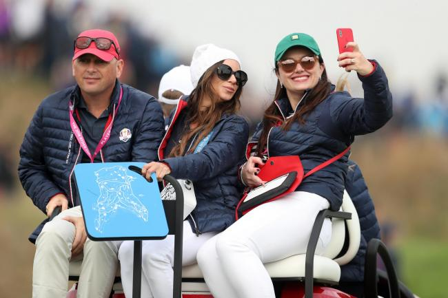 Tiger Woods' girlfriend Erica Herman, centre, poses for a selfie during the Ryder Cup in Paris last year