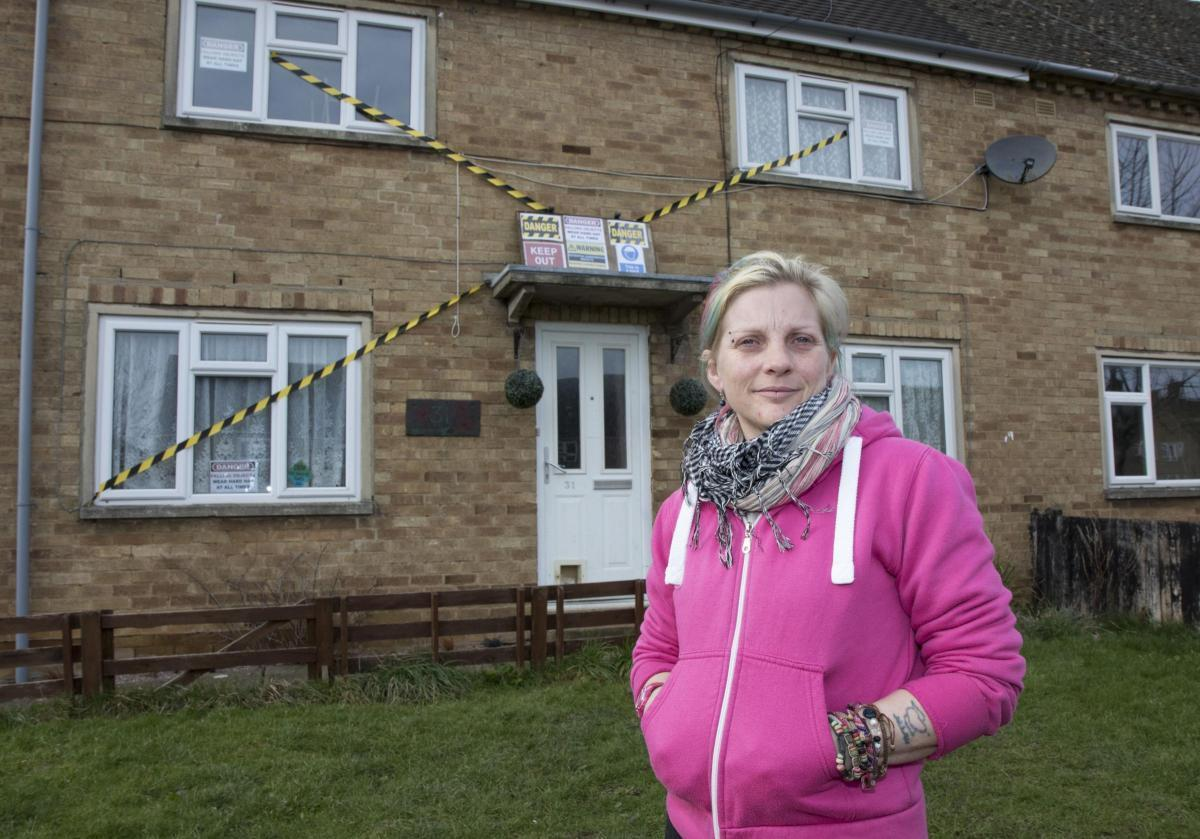 Muriel Swift put hazard tape over her house in 2016