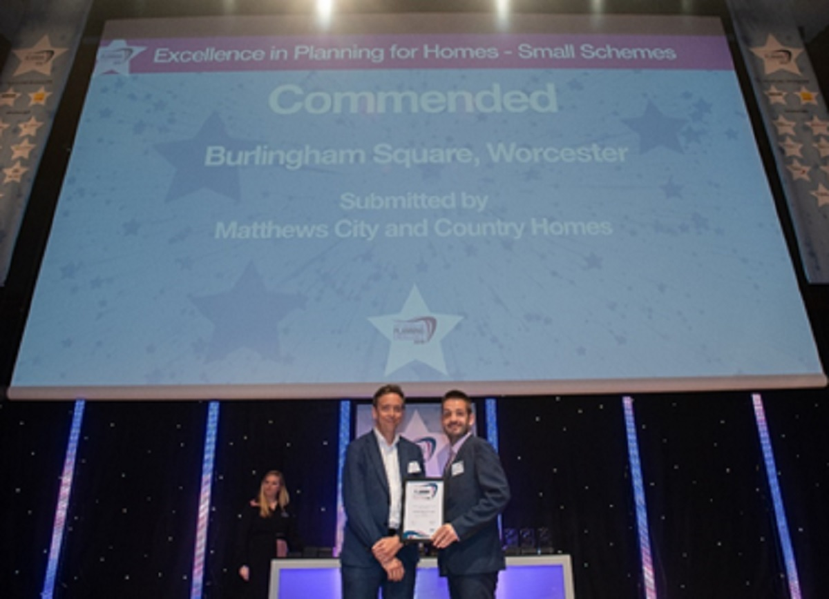 COMMENDED: Phil Deeley (right), planning manager at Matthews City and Country Homes collecting the award