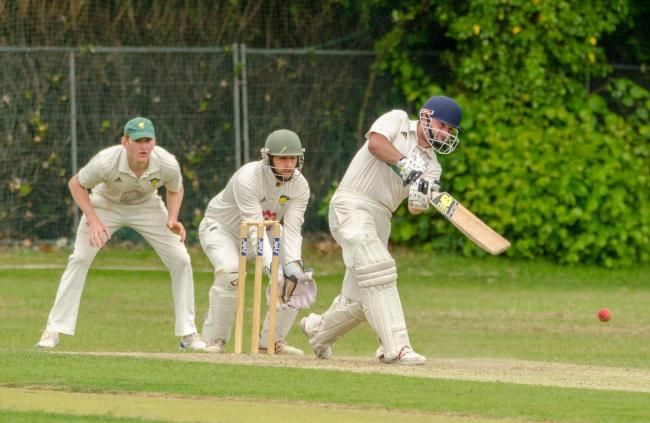 Opener Henry Lewis slams a four away for Worcester against Pershore in his team's convincing victory. Picture: ROGER KING