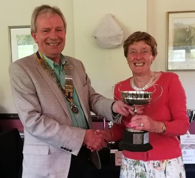 Gill Ashton, receiving her individual winner prize from Ed Alexander President of NCR